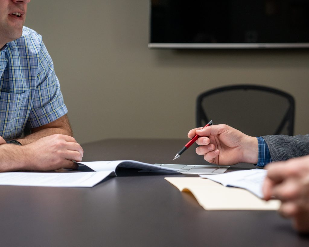 Insurance broker shows client details about an insurance policy.