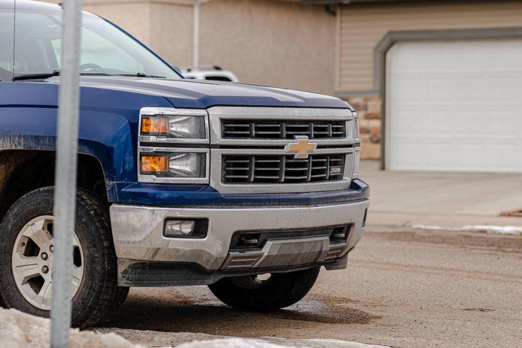 Blue Gmc Truck damage - auto insurance